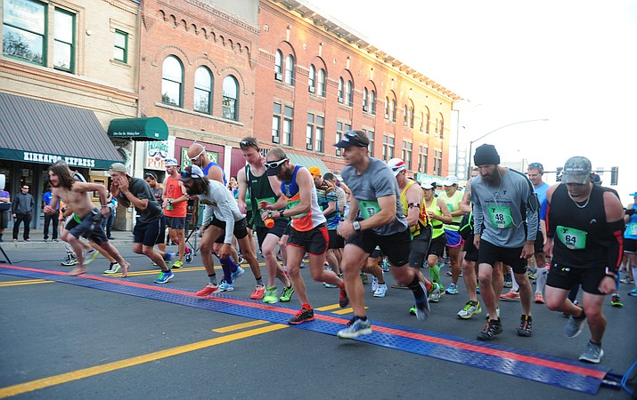 Runners start the marathon race during the 2015 Whiskey Row Marathon to benefit the Prescott YMCA scholarship fund.