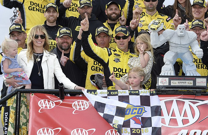 Matt Kenseth, center, poses with the trophy along with his wife Katie, left, and their three daughters after the race Sunday, May 15, at Dover International Speedway.