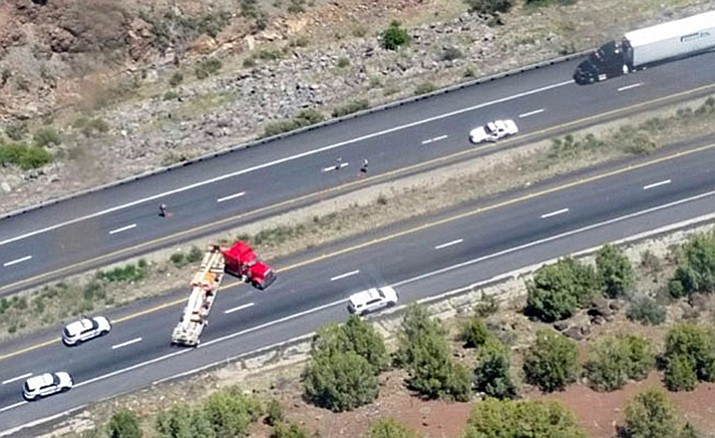 A tractor-trailer rig blocks Interstate 40 lanes Sunday afternoon, May 15, after its driver took DPS troopers on a 100-mile chase from the Kingman area to near Ash Fork.