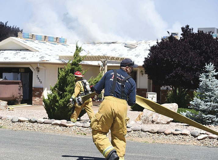 Central Arizona Fire crews respond to a structure fire in the 7900 block of Buena Vista Drive in Prescott Valley Friday morning. Division Chief Rick Chase said the fire was caused by a roofer using a torch on the roof..