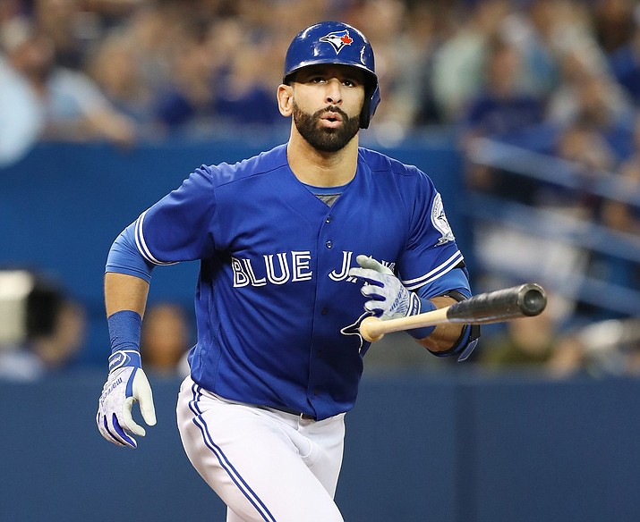 Toronto Blue Jays' Jose Bautista tosses his bat after popping out in the ninth inning of a baseball game against the Los Angeles Dodgers in Toronto on May 7. Bautista was suspended one game by Major League Baseball for his role in an on-field brawl between the Blue Jays and the Texas Rangers (Fred Thornhill/The Canadian Press via AP).