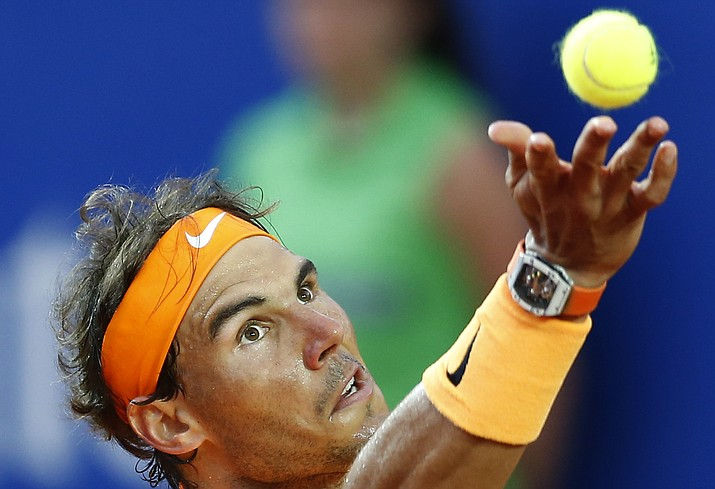 In this April 24, file photo, Spain's Rafael Nadal returns a ball to Japan's Kei Nishikori during the Barcelona Open tennis tournament final in Barcelona, Spain. The nine-time champion could face Novak Djokovic in the French Open semifinals this year.