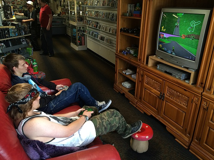 Bradley Pierman, front, and James Hill play Mario Kart 64 on Nintendo 64 at Black Box Gaming, a video game/stay and play store that recently opened in Prescott Valley.