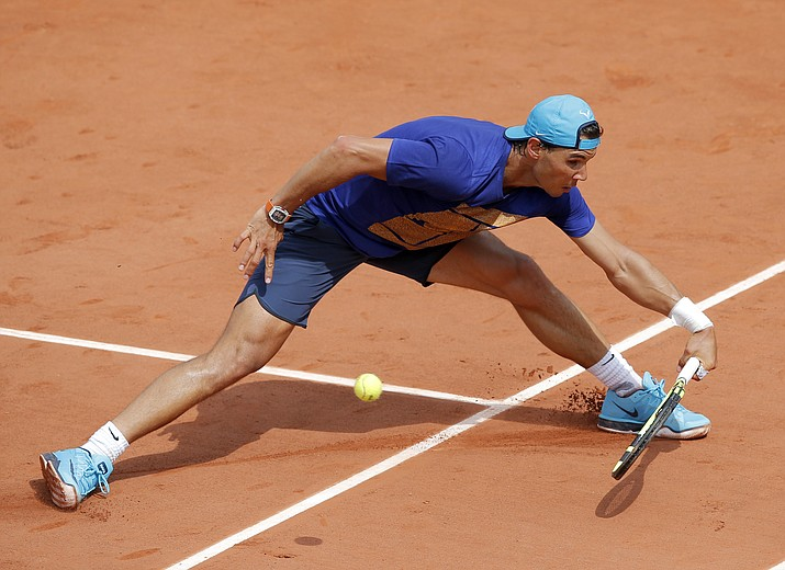 Spain's Rafael Nadal returns the ball during a training session of the French Open tennis tournament at the Roland Garros stadium Saturday in Paris. The French Open starts Sunday, May 22.