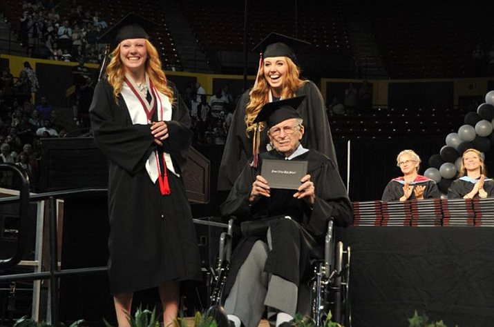 Fred Souther, with his twin granddaughters, Katelyn and Taylor Lawson,  shows off his diploma at the May 18 commencement ceremonies  at Desert Ridge High School in Mesa.