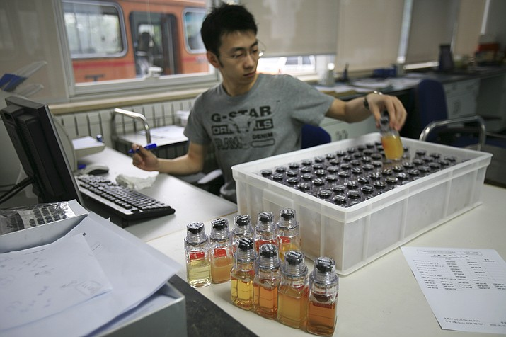 In this June 30, 2008 file photo, urine samples from Chinese athletes are recorded upon arriving at China Anti-Doping Agency in Beijing. So far, 31 unidentified athletes in six sports from 12 countries have been caught in retests of samples from the 2008 Beijing Games. Results on tests of 250 samples from the 2012 London Olympics will be known soon.