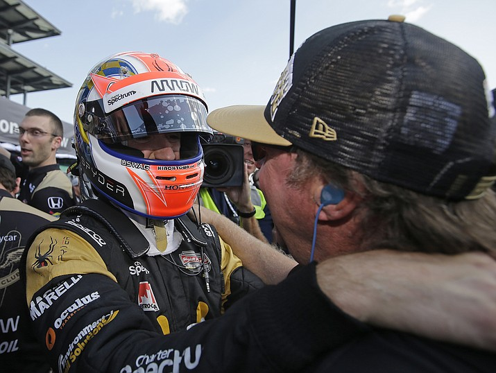 James Hinchcliffe, of Canada, celebrates with is father, Jeremy Hinchcliffe, after James won the pole for the Indianapolis 500 auto race at Indianapolis Motor Speedway on Sunday in Indianapolis.