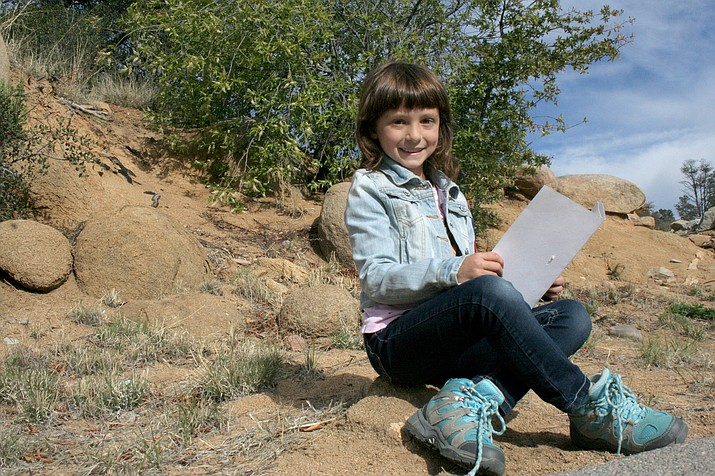 In this file photo from 2016, Roan Inhat, at that time 8 years old, reviewed the daily journal she kept when attending the Highlands Center week-long camp over spring break. Local summer camps start soon.