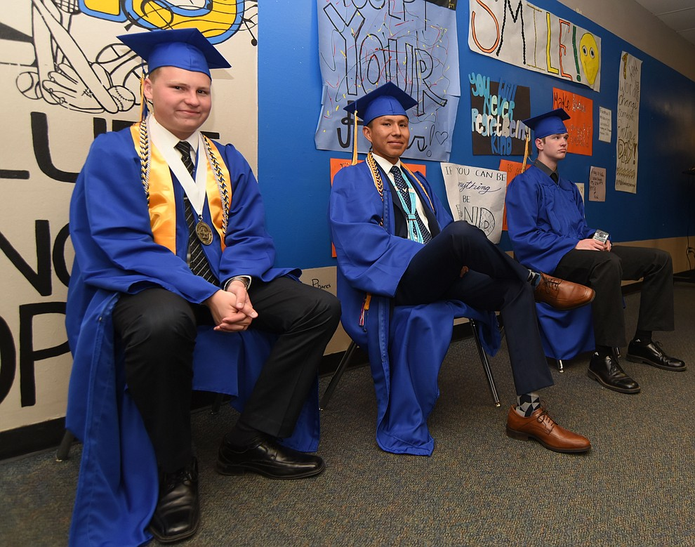 Colton Carter, Nakai Lake and Kayler Busse relax before in the main hallway before Prescott High School holds their Commencement Ceremony for the Class of 2016 on May 27, 2016.  (Les Stukenberg/The Daily Courier)