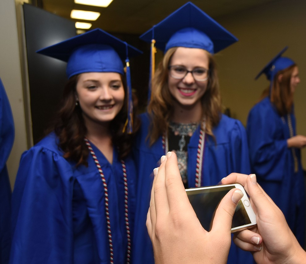 Sara Davidson and Julie Warne get a photo taken before Prescott High School holds their Commencement Ceremony for the Class of 2016 on May 27, 2016.  (Les Stukenberg/The Daily Courier)