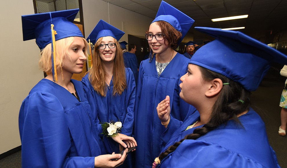 Hannah Nordman, Rachel Cope, Abbey Rainey and Rosemary Burgo share tales as Prescott High School holds their Commencement Ceremony for the Class of 2016 on May 27, 2016.  (Les Stukenberg/The Daily Courier)