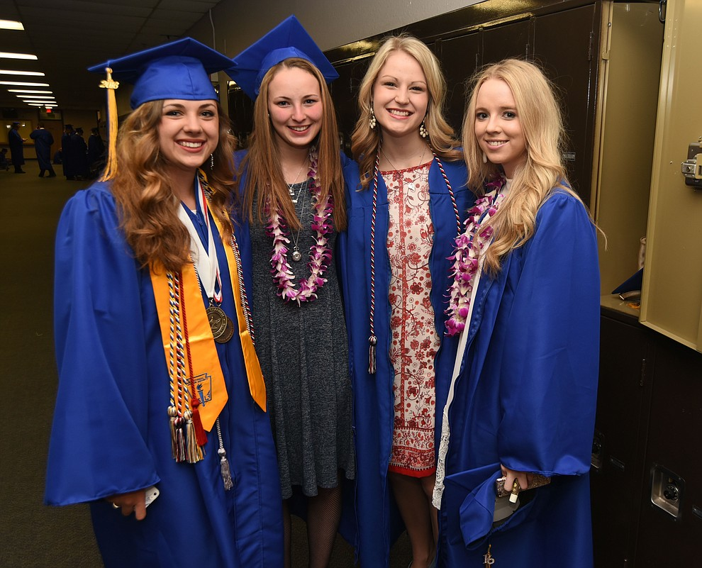 Makenzie Kimball, Tessa Bassett, Chantel Merrell and Riley Skipper pose for a photo before Prescott High School holds their Commencement Ceremony for the Class of 2016 on May 27, 2016.  (Les Stukenberg/The Daily Courier)