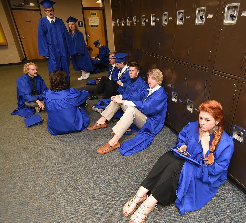 For some the waiting got tedious before Prescott High School holds their Commencement Ceremony for the Class of 2016 on May 27, 2016.  (Les Stukenberg/The Daily Courier)