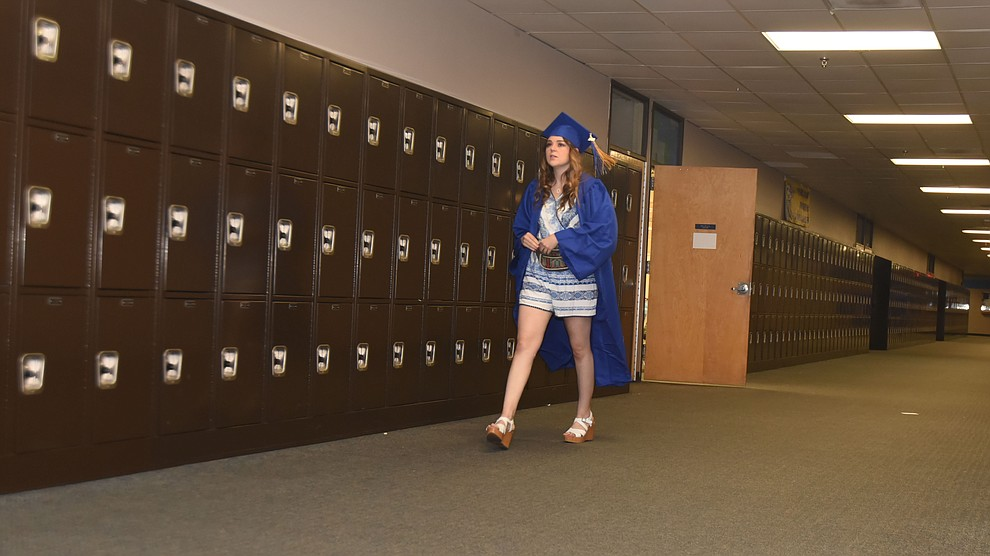 Kayley Roberts walks the lonely halls before Prescott High School holds their Commencement Ceremony for the Class of 2016 on May 27, 2016.  (Les Stukenberg/The Daily Courier)