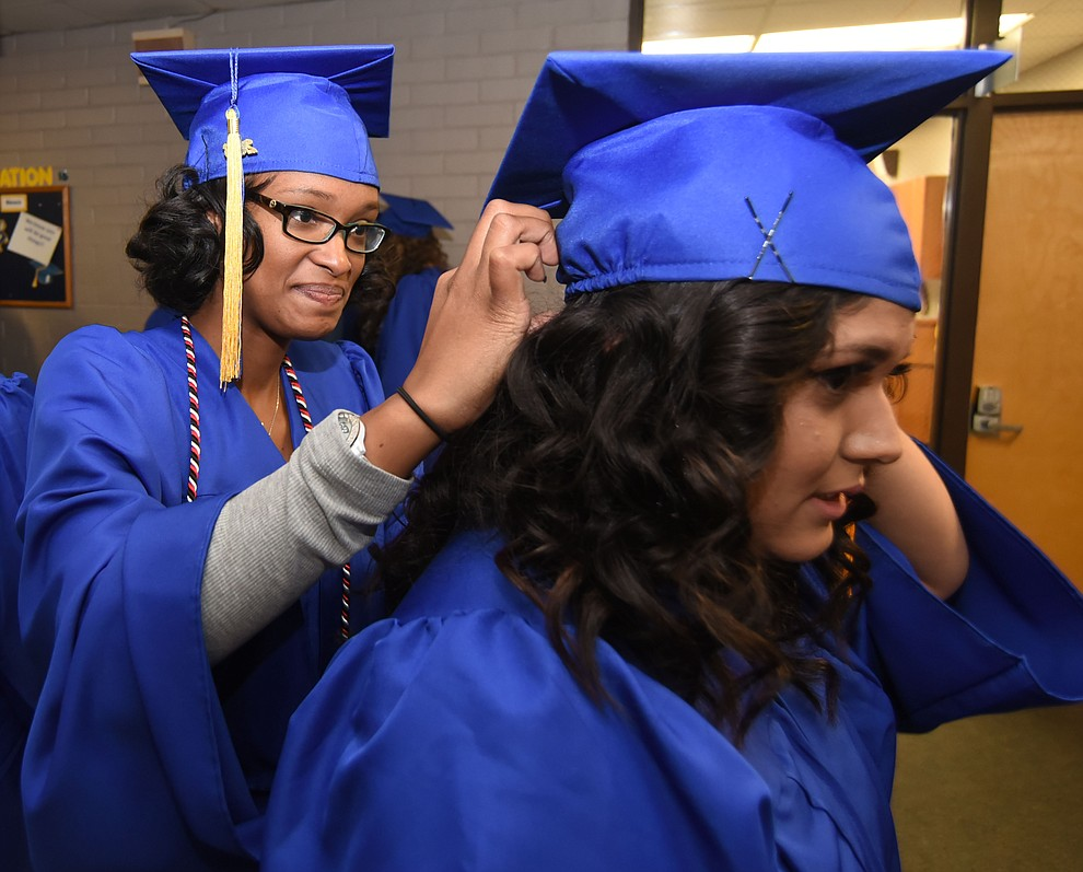 Samantha LeBlanc helps Jessica Sanchez adjust her cap as Prescott High School holds their Commencement Ceremony for the Class of 2016 on May 27, 2016.  (Les Stukenberg/The Daily Courier)