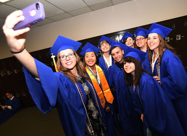 A quick group selfie before Prescott High School holds their Commencement Ceremony for the Class of 2016 on May 27, 2016.  (Les Stukenberg/The Daily Courier)
