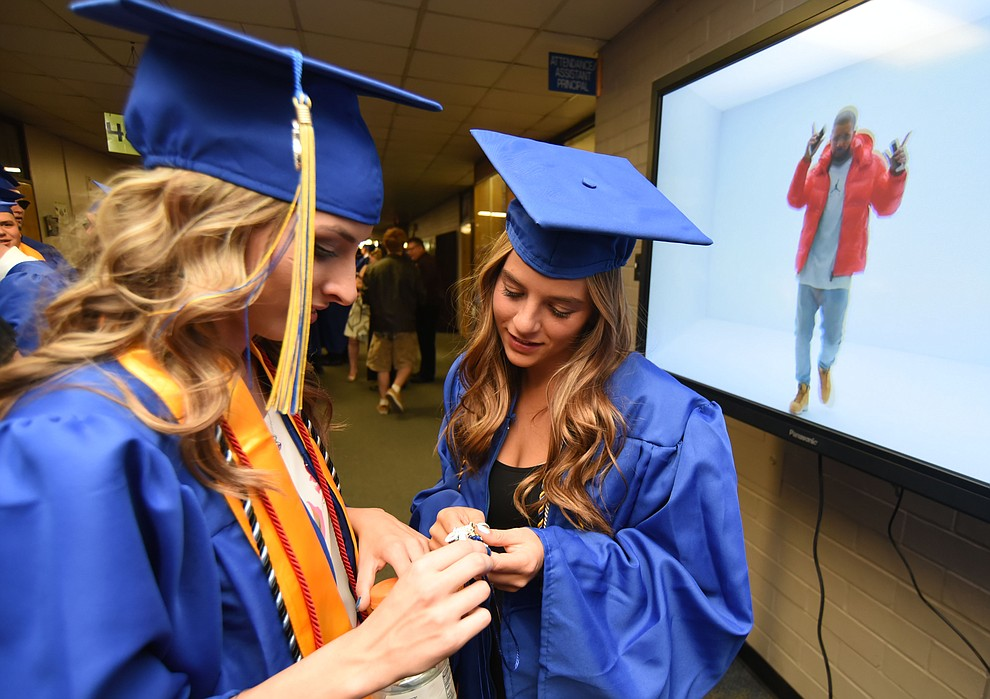 Mackenzie Grauberger and Morgan Feingold share a moment before Prescott High School holds their Commencement Ceremony for the Class of 2016 on May 27, 2016.  (Les Stukenberg/The Daily Courier)