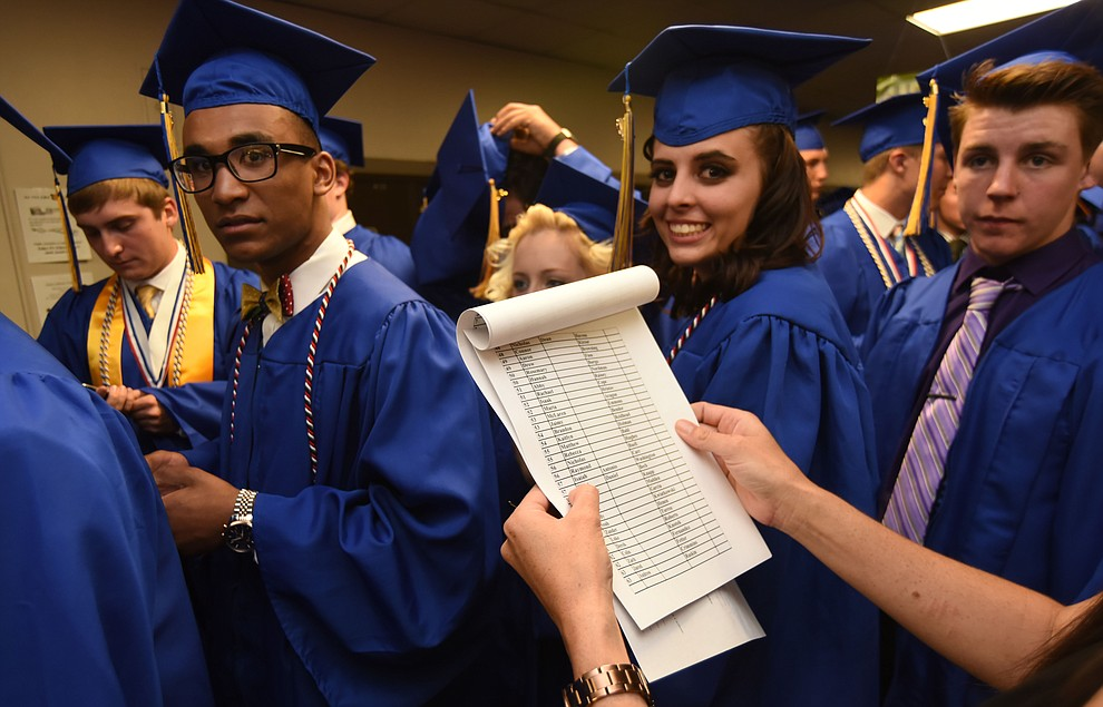 They made a list and checked it twice before Prescott High School holds their Commencement Ceremony for the Class of 2016 on May 27, 2016.  (Les Stukenberg/The Daily Courier)