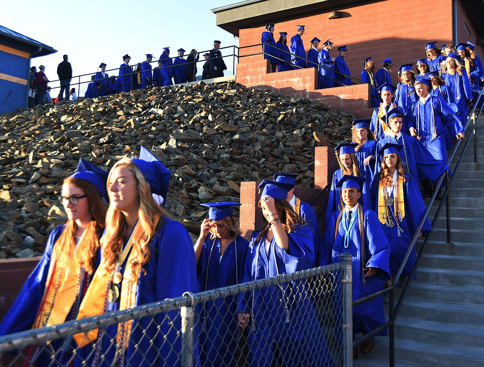 Students walk in the processional as Prescott High School holds their Commencement Ceremony for the Class of 2016 on May 27, 2016.  (Les Stukenberg/The Daily Courier)
