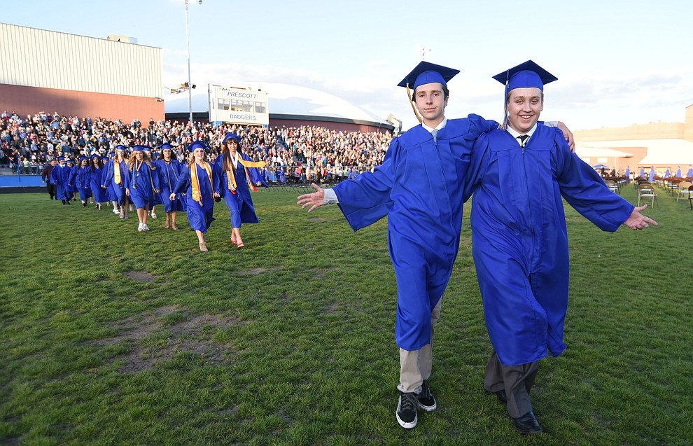 Students have fun as they walk in the processional during the Prescott High School Commencement Ceremony for the Class of 2016 on May 27, 2016.  (Les Stukenberg/The Daily Courier)