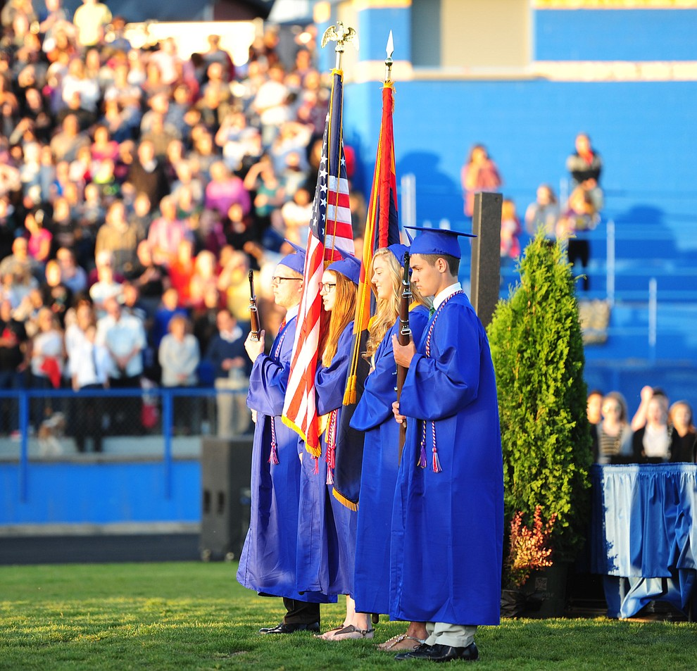 The Air Force JROTC Color Guard present the colors as Prescott High School holds their Commencement Ceremony for the Class of 2016 on May 27, 2016.  (Les Stukenberg/The Daily Courier)