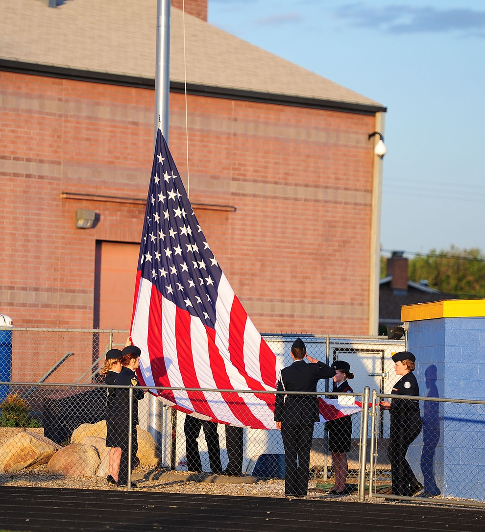 The Air Force JROTC Honor Guard raises the flag as Prescott High School holds their Commencement Ceremony for the Class of 2016 on May 27, 2016.  (Les Stukenberg/The Daily Courier)
