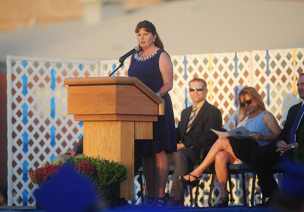 Principal Stephanie Hillig welcomes the guests and congratulates the graduates as Prescott High School holds their Commencement Ceremony for the Class of 2016 on May 27, 2016.  (Les Stukenberg/The Daily Courier)