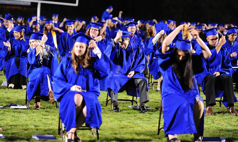 Graduates move their tassles to the left as Prescott High School holds their Commencement Ceremony for the Class of 2016 on May 27, 2016.  (Les Stukenberg/The Daily Courier)
