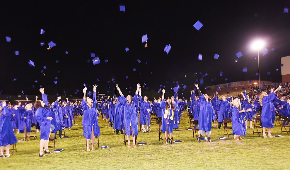 Caps are tossed in the air as Prescott High School holds their Commencement Ceremony for the Class of 2016 on May 27, 2016.  (Les Stukenberg/The Daily Courier)
