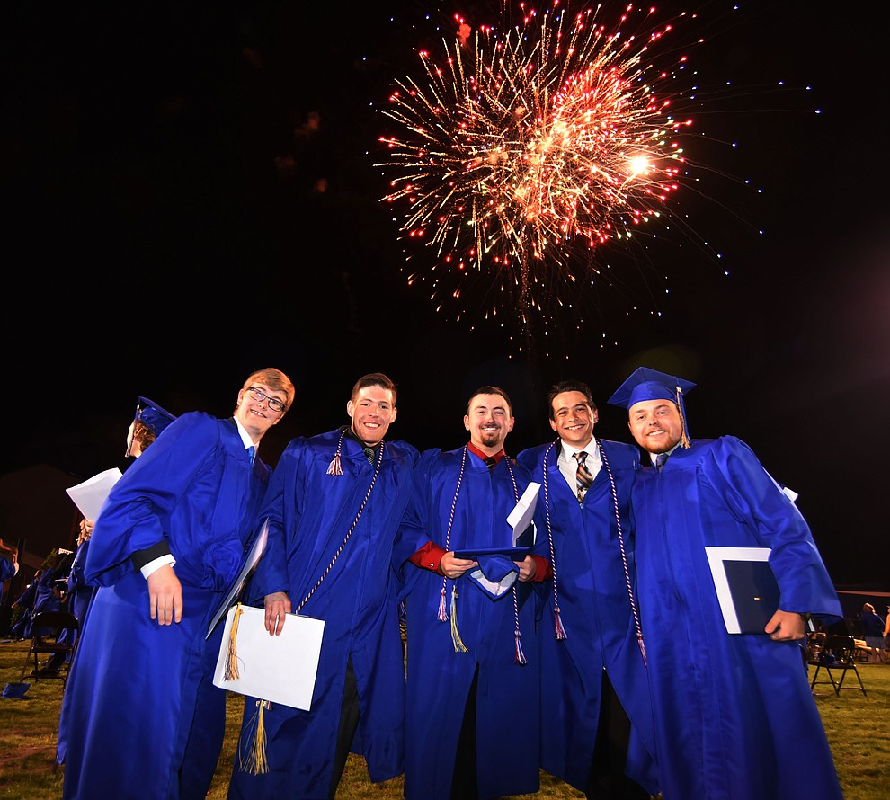 Graduates celebrate as Prescott High School holds their Commencement Ceremony for the Class of 2016 on May 27, 2016.  (Les Stukenberg/The Daily Courier)