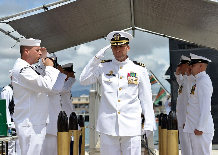 Commander Benjamin J. Selph, commanding officer, Los Angeles-class fast-attack submarine USS Olympia (SSN 717), salutes sideboys during a change-of-command ceremony in Joint Base Pearl Harbor-Hickam.