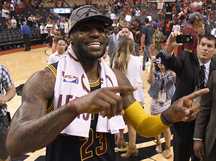 Cleveland Cavaliers forward LeBron James celebrates after Game 6 of the NBA basketball Eastern Conference finals against the Toronto Raptors, Friday, May 27, 2016, in Toronto. The Cavaliers won 113-87 and advanced to the NBA Finals.