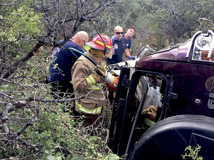 Jerome Fire Chief Rusty Blair said the man's Toyota FJ Cruiser four-wheel drive rolled 300 feet off Allen Springs Road down to Forest Road 493. Rescue crews had to hike with Jaws of Life extrication equipment to tear open the vehicle to get the man out.