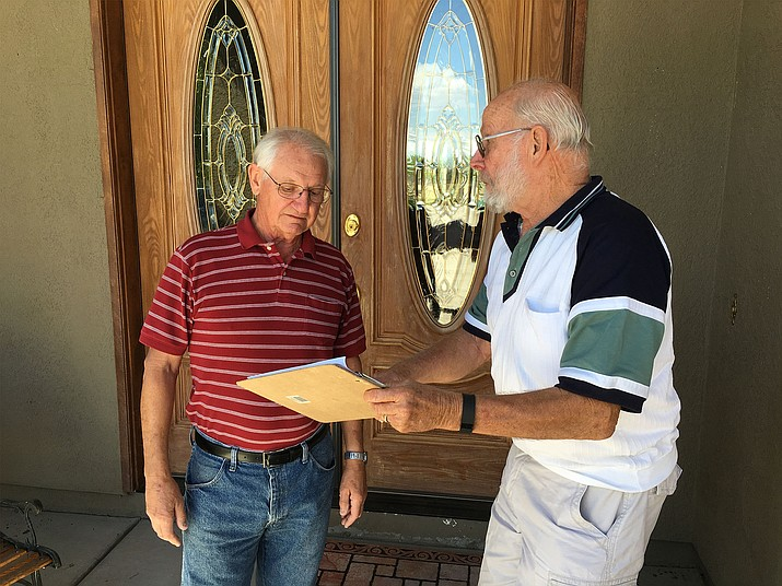 Robert McCaullay (right) and his neighbor Ronald Maines have been working on the petition drive to put McCaullay on the ballot for mayor in August's election.