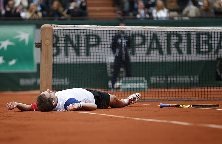 France's Richard Gasquet lies on the clay during his quarterfinal match against Britain's Andy Murray Wednesday, June 1, as part of the French Open tennis tournament at the Roland Garros stadium in Paris.