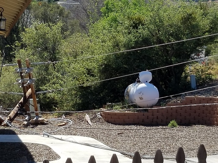 Mike Holt sent in this photo of the power lines that fell onto his neighbor's propane tank.