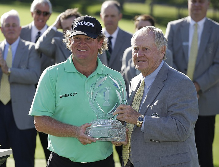Jack Nicklaus presents the trophy to William McGirt after McGirt won the Memorial golf tournament in a playoff, Sunday, June 5, in Dublin, Ohio.