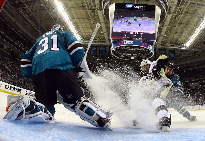 Pittsburgh Penguins' Bryan Rust, right, takes a shot against San Jose Sharks goalie Martin Jones during the third period of Game 4 of the NHL hockey Stanley Cup Finals on Monday, June 6, in San Jose, Calif.