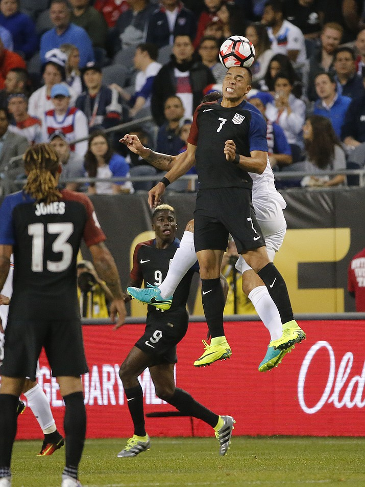 United States' Bobby Wood (7) and Costa Rica's Fancisco Calvo (3) battle during a Copa America Centenario group A soccer match Tuesday at Soldier Field in Chicago. (Charles Rex Arbogast/Associated Press)