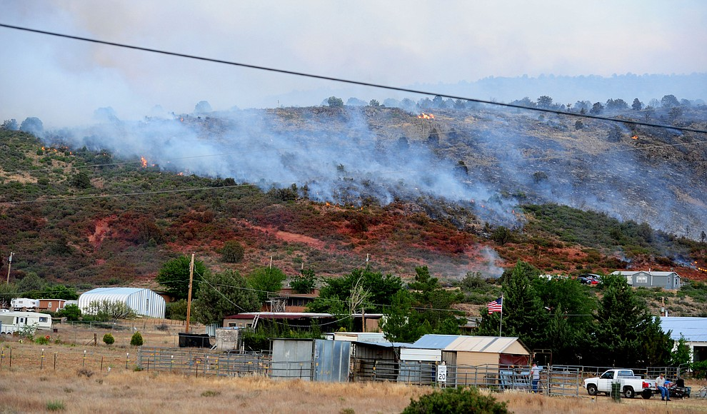 Fire burns along a slurry line as the blaze ripped through the hills on the south side of Yarnell Wednesday afternoon. (Les Stukenberg/The Daily Courier)