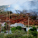 A slurry drop saved homes and power lines as fire burns through the hills on the south side of Yarnell Wednesday afternoon. (Les Stukenberg/The Daily Courier)