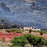 A fire crew gets a wet line down along with the line of slurry saving homes and businesses Fire burns through the hills on the south side of Yarnell Wednesday afternoon. (Les Stukenberg/The Daily Courier)