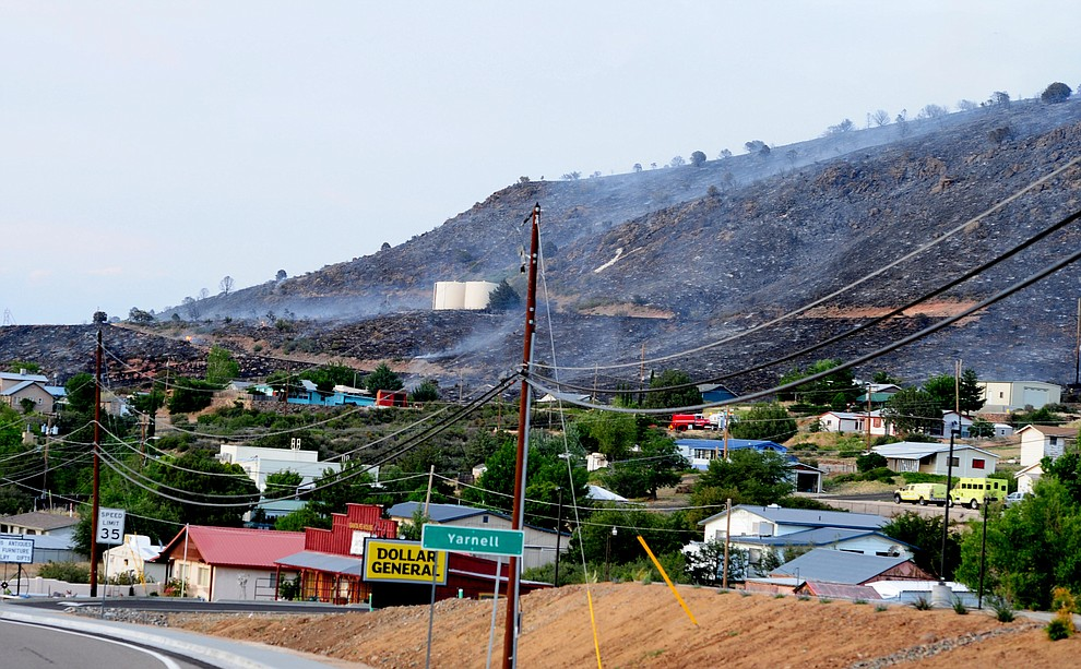 Fire burned through the hills on the south side of Yarnell Wednesday afternoon. (Les Stukenberg/The Daily Courier)