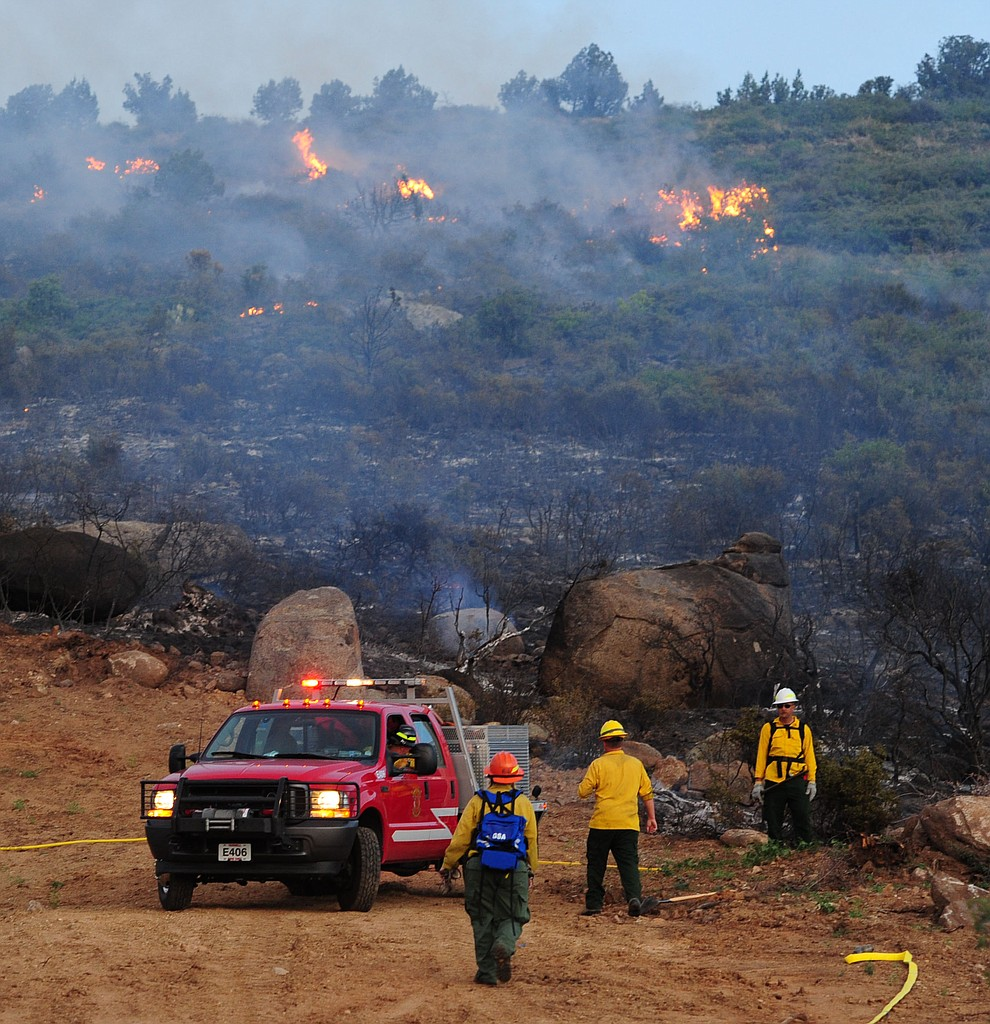 A type 6 crew gets water to hot spots as fire burns through the hills on the south side of Yarnell Wednesday afternoon. (Les Stukenberg/The Daily Courier)