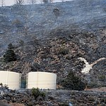 Fire burned around the water tanks and the Yarnell Y as it raced through the hills on the south side of Yarnell Wednesday afternoon. (Les Stukenberg/The Daily Courier)