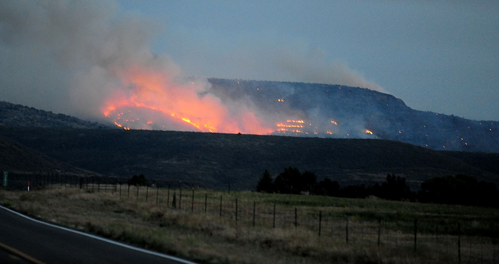 Fire still burns as night sets in through the hills on the south side of Yarnell Wednesday afternoon. (Les Stukenberg/The Daily Courier)
