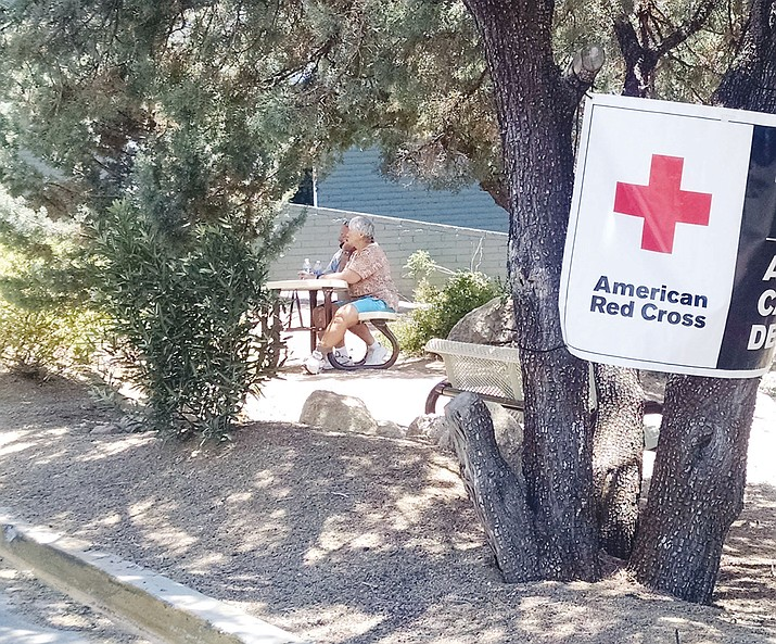 Dana and Janet Howe, 20-year residents of Yarnell, sit outside the Red Cross shelter at Yavapai College - hoping their home is still standing.