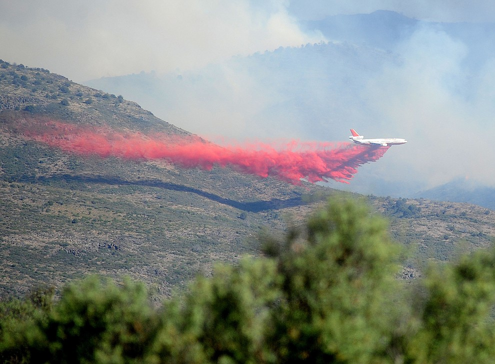A DC-10 heavy air tanker drops a load of retardent to create fire lines around the Tenderfoot Fire near Yarnell Thursday afternoon. (Les Stukenberg/The Daily Courier)