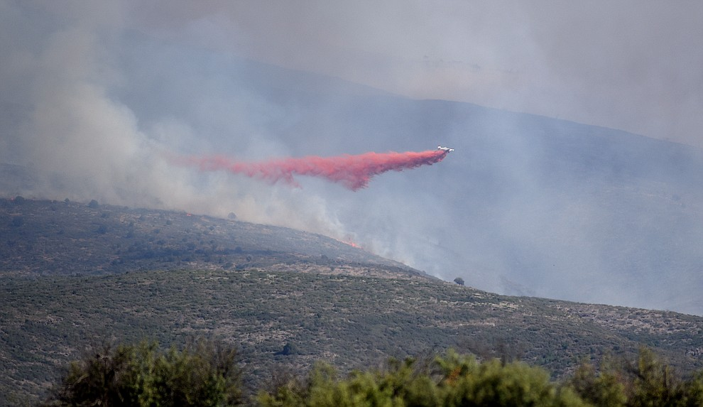 A SEAT drops a load of retardent to create fire lines around the Tenderfoot Fire near Yarnell Thursday afternoon. (Les Stukenberg/The Daily Courier)