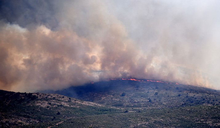 Flames hit a ridgeline on the Tenderfoot Fire near Yarnell Thursday afternoon. (Les Stukenberg/The Daily Courier)